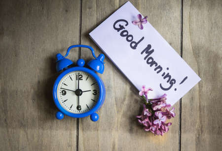 good morning: Lilac flowers and good morning note on the rustic style background