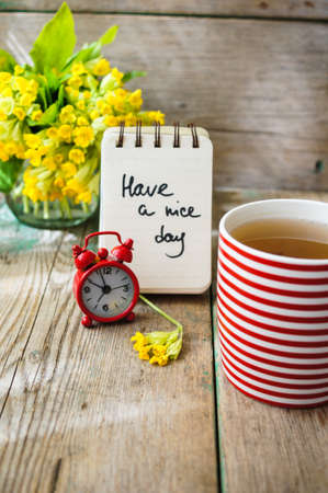stripped: Tea time, red stripped cup of tea, spring flowers and Have a nice day note