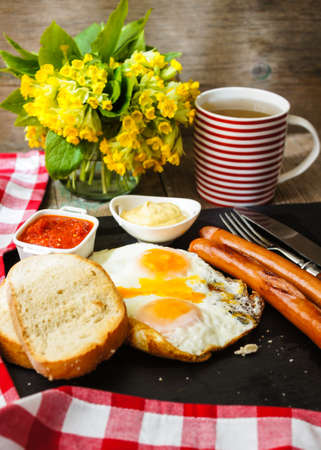 Lunch time with eggs and fried sausages photo