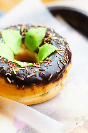 bright donuts on the wooden background photo