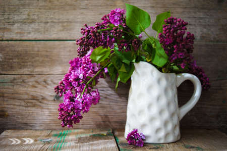 lilac: Lilac flowers in a pot in rustic interior