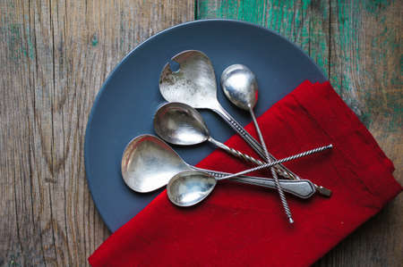 grunge flatware: Vintage silverware on the old wooden table
