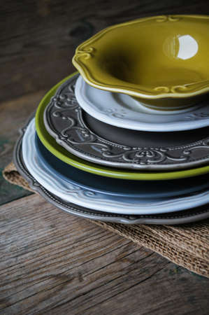 grunge flatware: Vitage plates on the wooden table Stock Photo