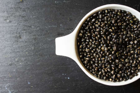 blacked: Black beans or Black turtle bean on the black stone background