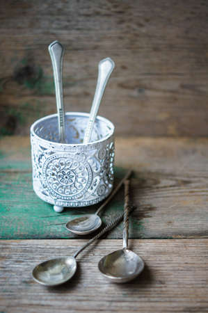 Vintage silverware on the old wooden table