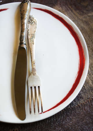 grunge flatware: Plate and silverware on the old wooden table with burlap and napkin