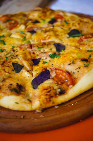 margherita: Pizza Margherita on the wooden plate Stock Photo