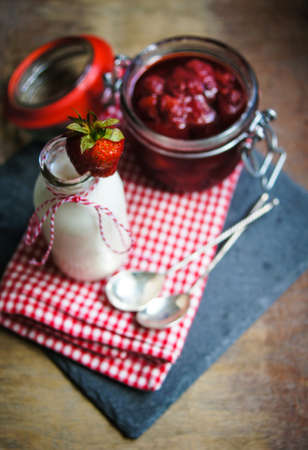 rustic kitchen: Strawberries yogurt and fresh fruits on the rustic kitchen Stock Photo