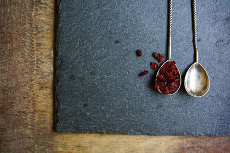 dried goji berries on the rustic style old table photo