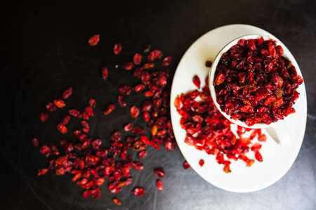 superfruit: dried goji berries on the rustic style old table
