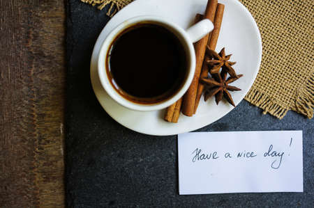 coffee time: Coffee time, cup of black coffee and cinnamon and anise spices, Good morning note