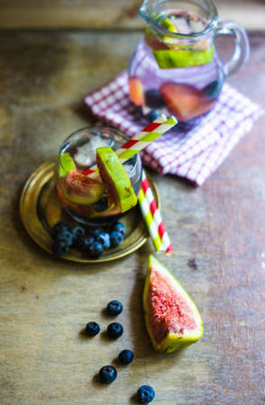 Cold lemonade with figs, blueberry, and plums Stock Photo