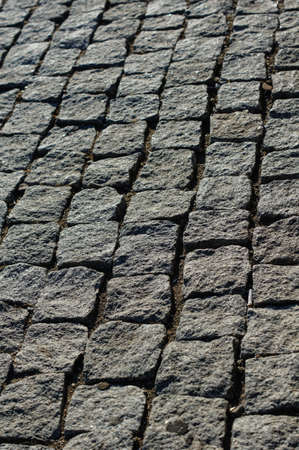 unclean: Dirty and unclean urban ground made with cobblestones