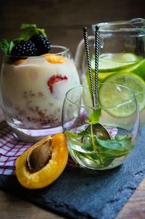 musli: Musli, yogurt and blackberries with mint, selective focus