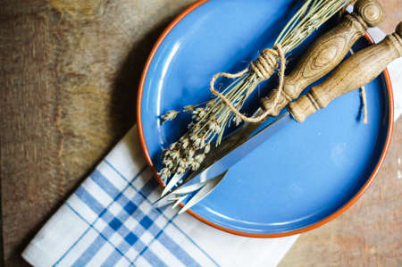 lowers: Rustic Table Setting with napkin, silverware and dry lavendre lowers on old wooden table Stock Photo