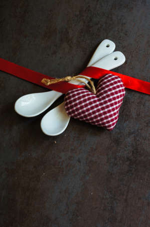 ribbin: Table set for celebration St. Valentines Day with red ribbin on dask stone background