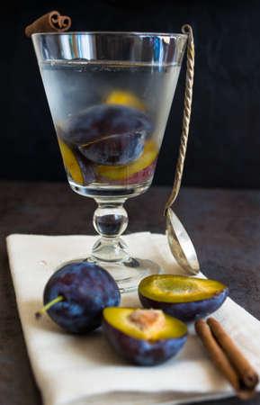 Plum detox lemonade with cinnamon and anise spice, vintage style Stock Photo