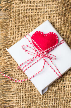 heart gift box: Presents withred heart on wooden board for valentines day Stock Photo