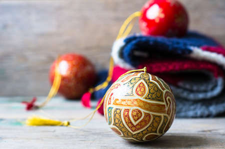 christmas golf: Christmas Balls on Knitted Gifts on wooden background