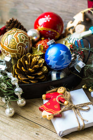 cristmas card: Christmas vintage decorations and present box on the old rustic background Stock Photo