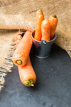 rustic food: Diet food fresh carrot sticks in vintage bowl on the rustic wooden background