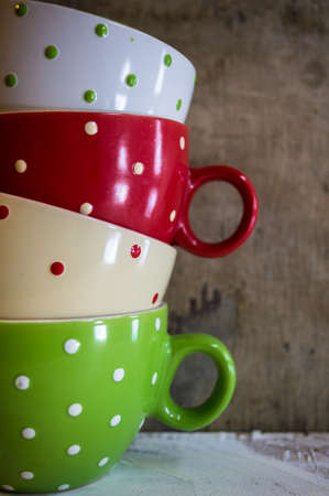 household objects: Multi colored empty big polka dot bowls on the wooden table in rustic style