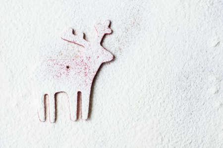 white flour: Christmas deer on the white flour background Stock Photo