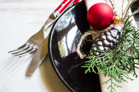 cone shaped: Christmas table setting with vintage silverware and napkin with christmas balls decorations Stock Photo