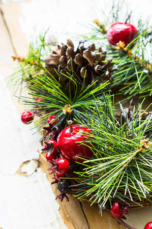 cone shaped: Christmas time interior decorations on the rustic background with candle lamp and fir tree