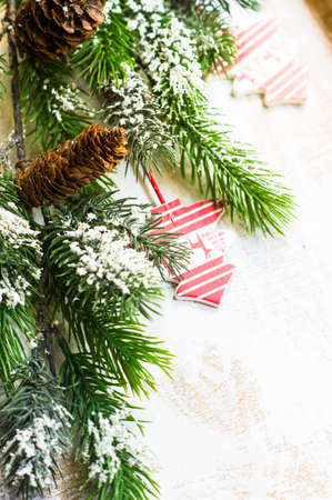 cone shaped: Christmas time decorations and fir tree on old white wooden table