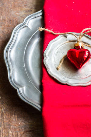 christmas food: Christmas table setting with vintage silverware and christmas decoration on rustic wooden table