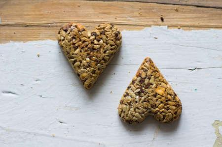 baklawa: Eastern sweets: heart shaped baklava with the nuts, closeup of eastern sweet dessert