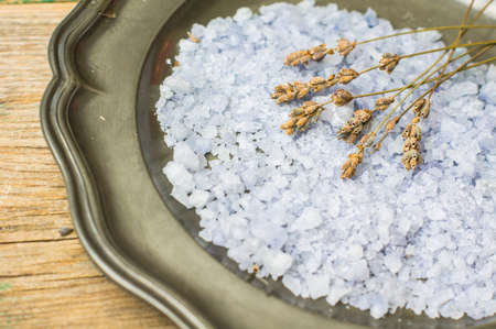 essences: Flowers of dried lavender flowers and sea salt on vintage plate