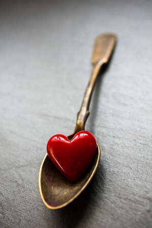 grunge cutlery: Vintage silverware and heart on rustic wooden background