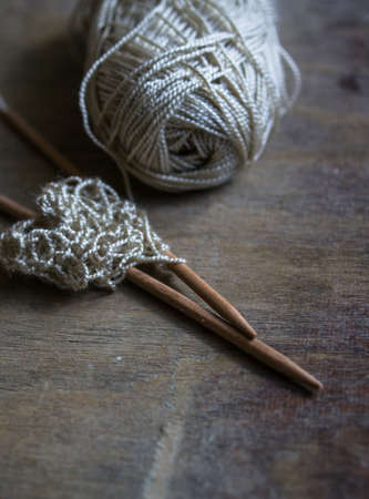 cable knit: Vintage Knitting needles and yarn on wooden rustic table