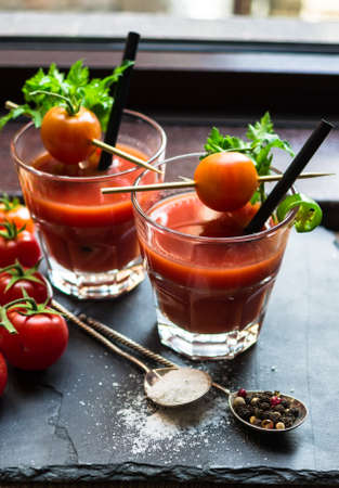 tabasco: Fresh tomato juice with cherry tomatoes and chili pepper on rustic background Stock Photo