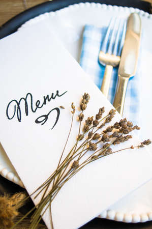 setting table: Table setting in rustic style with Menu