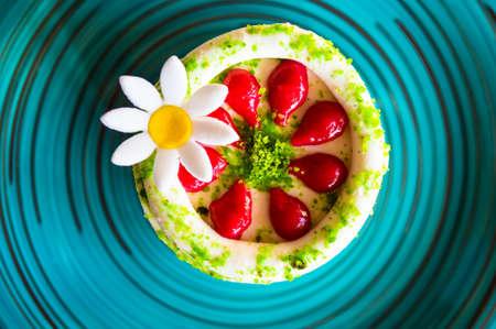 boulangerie: traditional european dessert on vintage porcelain plate onn rustic table