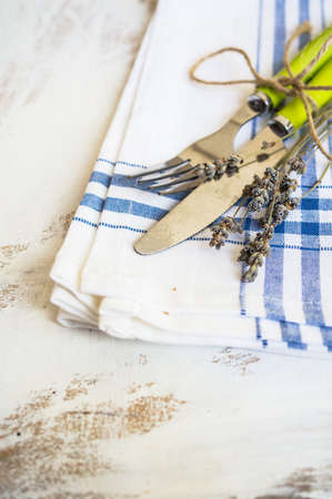grunge flatware: Rustic table setting with vintage silverware and bright color napkin Stock Photo