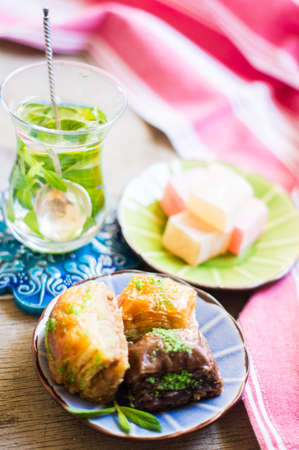 turkish dessert: Traditional turkish dessert - mint tea and bakhlava on rustic background