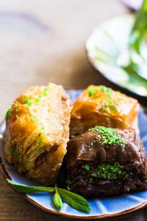 baklawa: Traditional turkish dessert - mint tea and bakhlava on rustic background