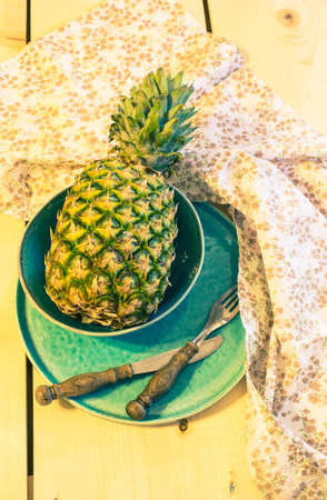 toned: Fresh ananas fruit on vintage style plate. Toned image