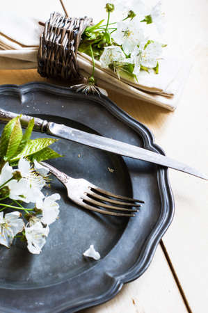 blossom time: Spring time table setting with rustic plates and cherry blossom Stock Photo