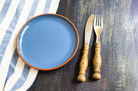 table setting: Rustic table setting with vintage plates and silverware Stock Photo