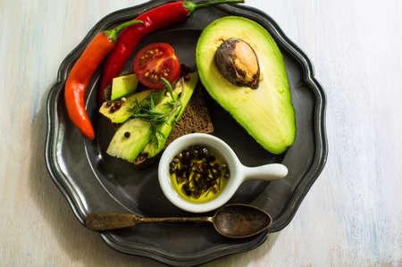 peper: Bruschetta with tomato, avocado, chilli peper and herbs