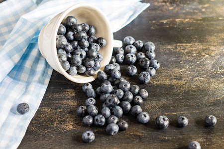rustic kitchen: Fresh organic bilberry fruits on rustic kitchen table
