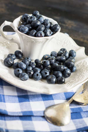 bilberry: Fresh organic bilberry fruits on rustic kitchen table