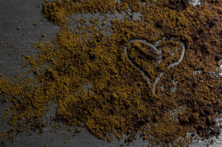 dusting: Love with dusting coffee on rustic wooden background Stock Photo