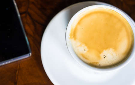 Cup of cappuccino on rustic table
