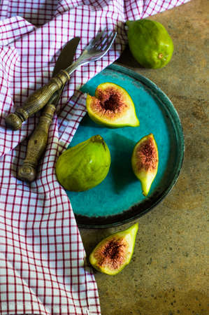 Ripe fig fruits on the stone rustic table